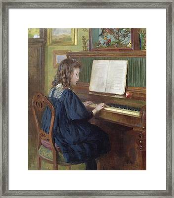 Playing The Piano Framed Print by Ernest Higgins Rigg