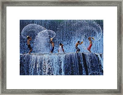Playing With Splash Framed Print by Angela Muliani Hartojo