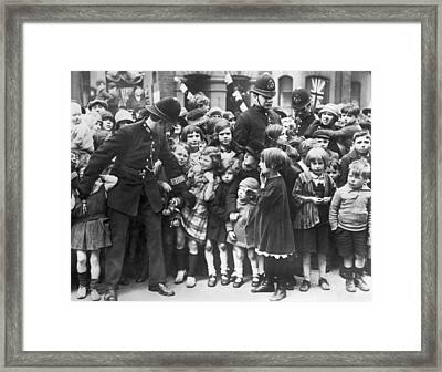 Police Restraining Children Framed Print by Underwood Archives