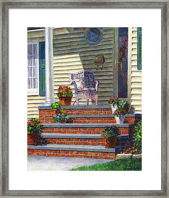 Porch With Pots Of Geraniums Framed Print by Susan Savad