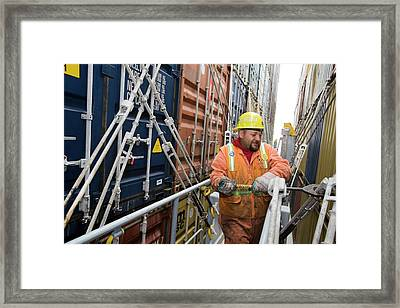 Port Worker Handling Cargo Containers Framed Print by Jim West