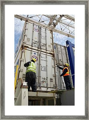 Port Workers Handling Cargo Containers Framed Print by Jim West