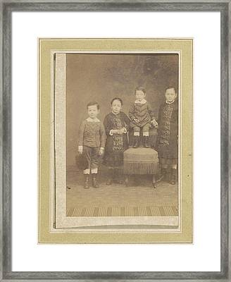 Portrait Of Four Children In A Chair, Anonymous Framed Print by Artokoloro