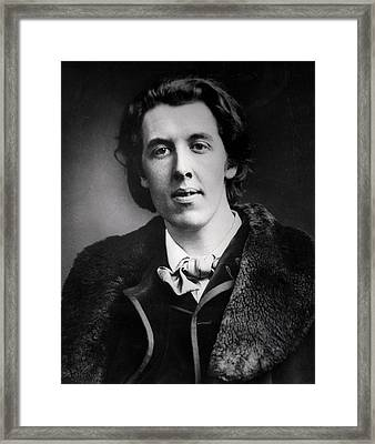 Portrait Of Oscar Wilde 1854-1900 Wearing An Overcoat With A Fur Collar Bought For His Trip Framed Print by English Photographer