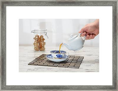 Pouring A Cup Of Tea Framed Print by Amanda Elwell
