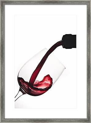 Pouring A Drink Framed Print by Andrew Soundarajan