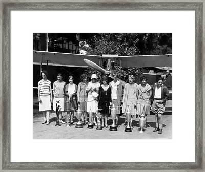 Powderpuff Derby Aviatrix Framed Print by Underwood Archives
