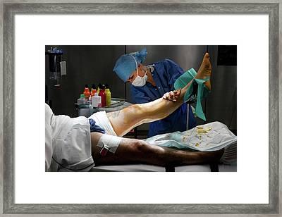 Preparation For Knee Surgery Framed Print by Patrick Landmann
