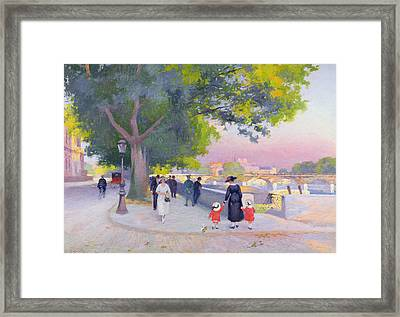 Promenade On The Banks Of The Seine Framed Print by Jules Ernest Renoux