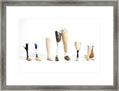 Prosthetic Legs Framed Print by Gregory Davies
