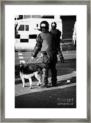 Psni Dog Handler In Riot Gear With Dog On Crumlin Road At Ardoyne Shops Belfast 12th July Framed Print by Joe Fox
