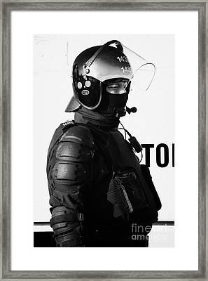 Psni Officer In Ninja Riot Geat On Crumlin Road At Ardoyne Shops Belfast 12th July Framed Print by Joe Fox