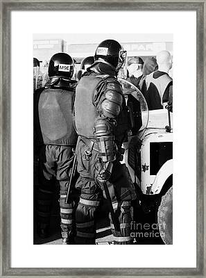 Psni Officer In Riot Gear With Shield And Baton On Crumlin Road At Ardoyne Shops Belfast 12th July Framed Print by Joe Fox