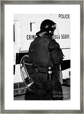 Psni Officer With Riot Gear On Crumlin Road At Ardoyne Shops Belfast 12th July Framed Print by Joe Fox