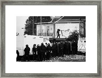 Psni Riot Officers Behind Armoured Land Rover Water Cannon Beneath On Crumlin Road At Ardoyne Shops  Framed Print by Joe Fox