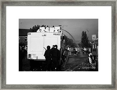 Psni Riot Officers Behind Water Canon During Rioting On Crumlin Road At Ardoyne Framed Print by Joe Fox