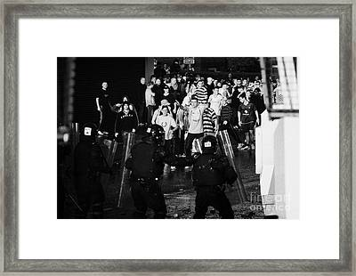 Psni Riot Police Face Angry Mob Of Rioters On Crumlin Road At Ardoyne Shops Belfast 12th July Framed Print by Joe Fox