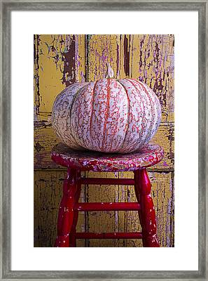 Pumpkin Sitting On Red Stool Framed Print by Garry Gay