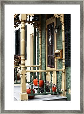 Pumpkins On The Porch Framed Print by John Rizzuto