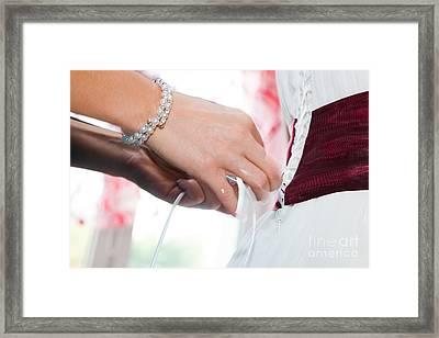 Putting On A Wedding Dress Framed Print by Michal Bednarek