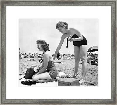 Putting On Sun Tan Lotion Framed Print by Underwood Archives