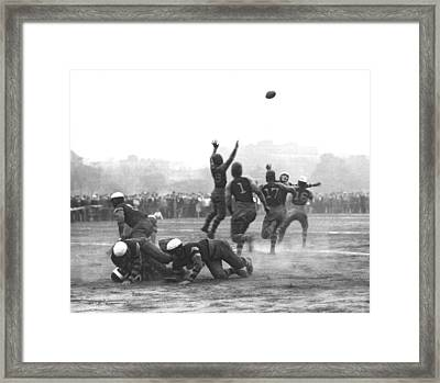 Quarterback Throwing Football Framed Print by Underwood Archives