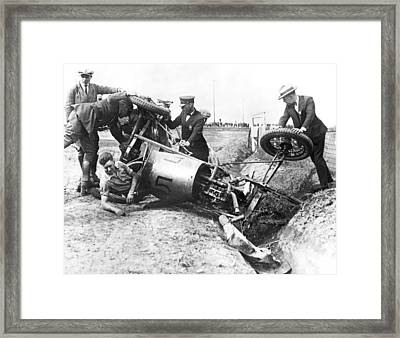 Race Car Driver Crashes Framed Print by Underwood Archives