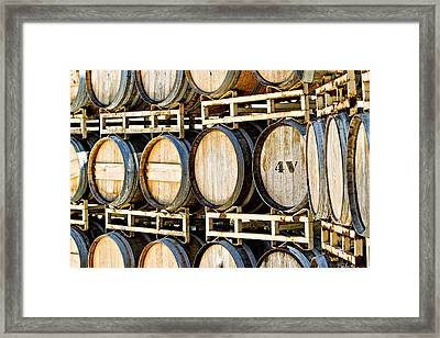 Rack Of Old Oak Wine Barrels Framed Print by Susan Schmitz