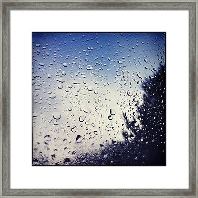 Rain Drops On A Window Pane Framed Print by Marco Oliveira