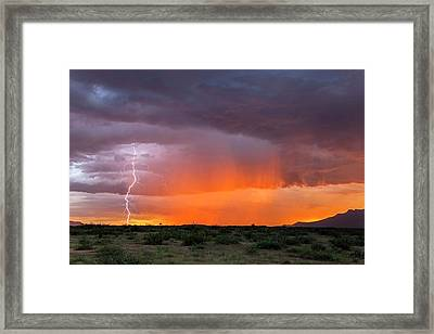 Rain Storm At Sunset Framed Print by Roger Hill