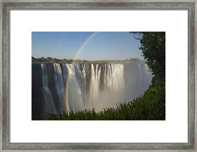 Rainbows In The Mist Of Victoria Falls Framed Print by Vincent Grafhorst
