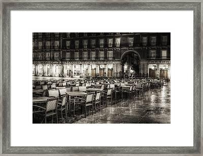 Rainy Plaza Framed Print by Joan Carroll