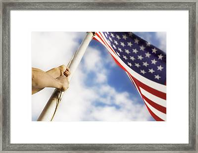Raising An American Flag Framed Print by Chris and Kate Knorr