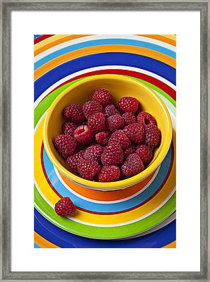 Raspberries In Yellow Bowl On Plate Framed Print by Garry Gay