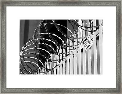 Razor Wire Framed Print by Les Cunliffe