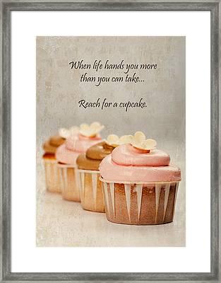 Reach For A Cupcake Framed Print by Susan Schmitz