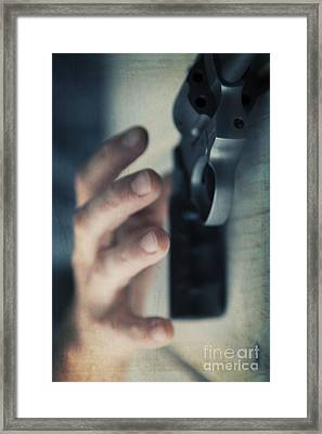 Reaching For A Gun Framed Print by Edward Fielding