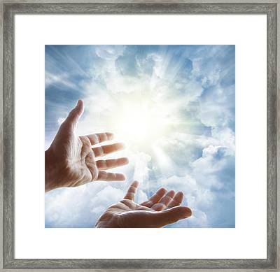 Reaching Framed Print by Les Cunliffe