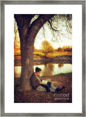 Reading Under The Tree Framed Print by Carlos Caetano