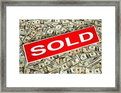 Real Estate Sold Sign Over Dollar Money Background Framed Print by Olivier Le Queinec