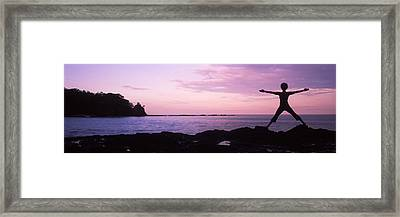 Rear View Of A Woman Exercising Framed Print by Panoramic Images