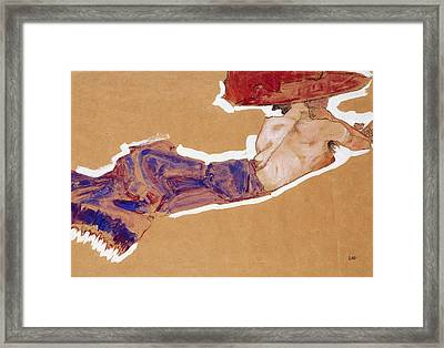 Reclining Semi-nude With Red Hat Framed Print by Egon Schiele