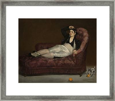 Reclining Young Woman In Spanish Framed Print by Edouard Manet