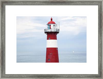 Red And White Lighthouse Framed Print by Peter Zoeller