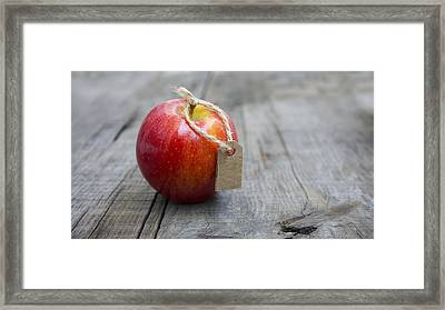 Red Apple With A Price Label Framed Print by Aged Pixel
