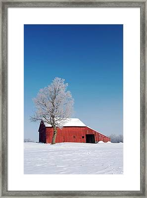 Red Barn In Snow Framed Print by Jim West