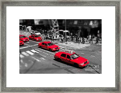 Red Cabs On Time Square Framed Print by Hannes Cmarits