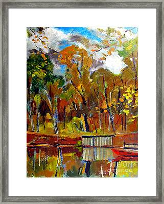 Red Canoe On The Lake Framed Print by Charlie Spear
