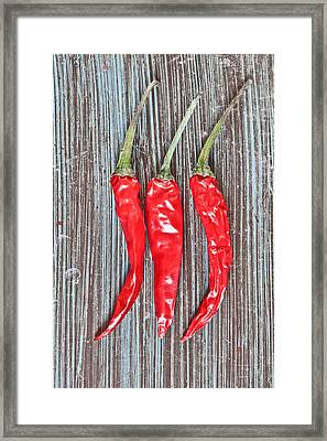 Red Chilis Framed Print by Tom Gowanlock
