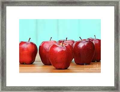 Red Delicious Apples On Old School Desk Framed Print by Sandra Cunningham
